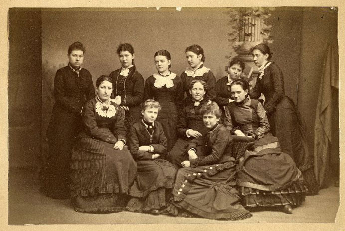 A photo of a group of eleven female students from 1878.